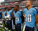 Tennessee Titans quarterback Jake Locker (10) stands with teammates during the playing of the national anthem before a preseason NFL football game between the Titans and the Washington Redskins on Thursday, Aug. 8, 2013, in Nashville, Tenn. (AP Photo/Wade Payne)