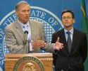 Washington state Gov. Jay Inslee, left, is joined by state Attorney General Bob Ferguson as he talks to the media in Olympia, Wash. about the federal government's announcement that it will not sue to stop Washington and Colorado from taxing and regulating recreational marijuana for adults, on Thursday, Aug. 29, 2013. Last fall, voters made both states the first in the country to legalize the sale of marijuana to adults over 21 at state-licensed stores. The states are creating rules for the system, with sales expected to begin early next year.