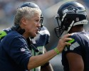 Seattle Seahawks head coach Pete Carroll, left, talks with quarterback Russell Wilson, right, during the second half of an NFL football game against the Carolina Panthers in Charlotte, N.C., Sunday, Sept. 8, 2013. Seattle won 12-7.
