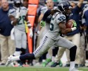 Seattle Seahawks' Richard Sherman loses his shoe as he returns an interception for a touchdown during the fourth quarter an NFL football game against the Houston Texans, Sunday, Sept. 29, 2013, in Houston.
