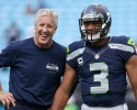 In this Sept. 8, 2013 file photo, Seattle Seahawks coach Pete Carroll, left, talks with quarterback Russell Wilson before an NFL football game against the Carolina Panthers in Charlotte, N.C. The Seahawks are scheduled to play the San Francisco 49ers on Sunday, Sept. 15, 2013.