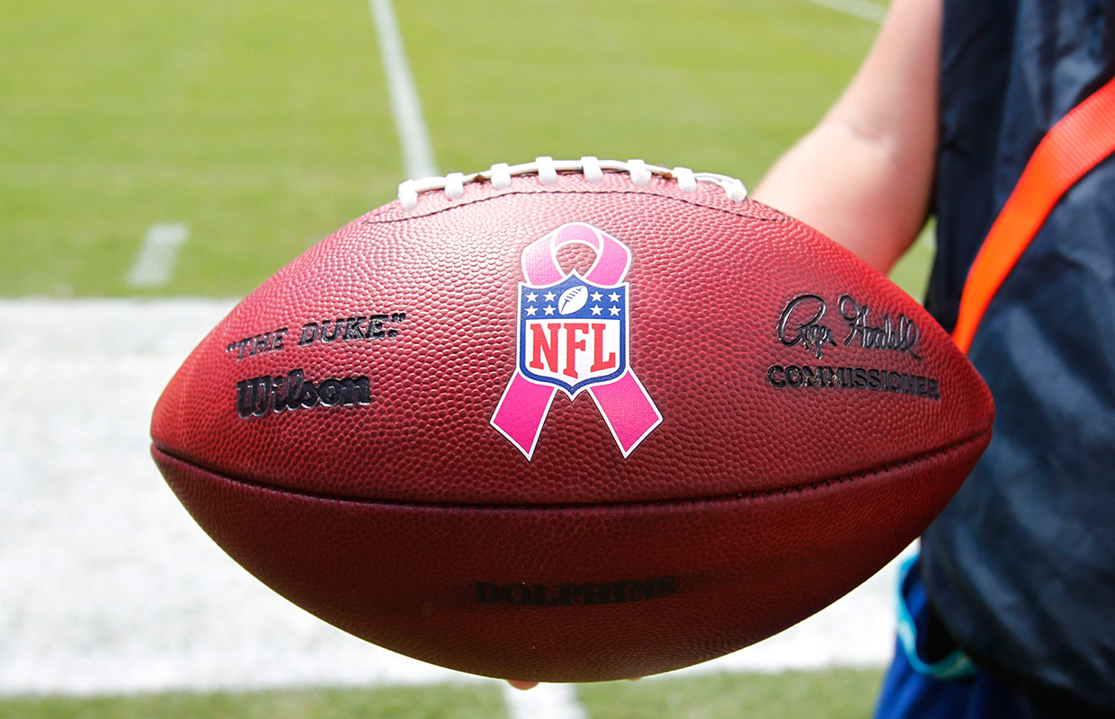 An NFL football with a Breast Cancer Awareness logo during the first half of an NFL football game between the Miami Dolphins and the Baltimore Ravens, Sunday, Oct. 6, 2013, in Miami Gardens, Fla. (AP Photo/Wilfredo Lee)