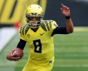 Oregon quarterback Marcus Mariota (8) runs with the ball during the first quarter of an NCAA college football game against Tennessee in Eugene, Ore., Saturday, Sept. 14, 2013. Oregon won 59-14.
