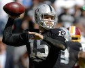 Oakland Raiders quarterback Matt Flynn (15) passes against the Washington Redskins during the second quarter of an NFL football game in Oakland, Calif., Sunday, Sept. 29, 2013. (AP Photo/Marcio Jose Sanchez)