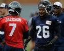 Seattle Seahawks backup quarterback Tarvaris Jackson (7) talks with Michael Robinson (26) during NFL football training camp, Thursday, Aug. 1, 2013, in Renton, Wash.