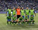 Seattle Sounders players including goalkeeper Michael Gspurning, third from top left, and Clint Dempsey, second from top right, pose for the traditional team portrait before an MLS soccer match against the Los Angeles Galaxy, Sunday, Oct. 27, 2013, in Seattle.