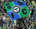 Seattle Sounders supporters wave a giant flag before an MLS soccer match against the New England Revolution, Saturday, April 13, 2013, in Seattle.
