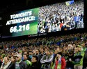 The attendance at an MLS soccer match between the Seattle Sounders and the Los Angeles Galaxy is announced, Sunday, Oct. 27, 2013, in Seattle. The Sounders set the record for highest average attendance of any MLS club during the 2013 season.