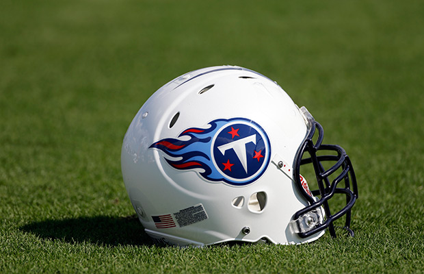 A Tennessee Titans helmet sits on a practice field during NFL football training camp on Thursday, July 25, 2013, in Nashville, Tenn.