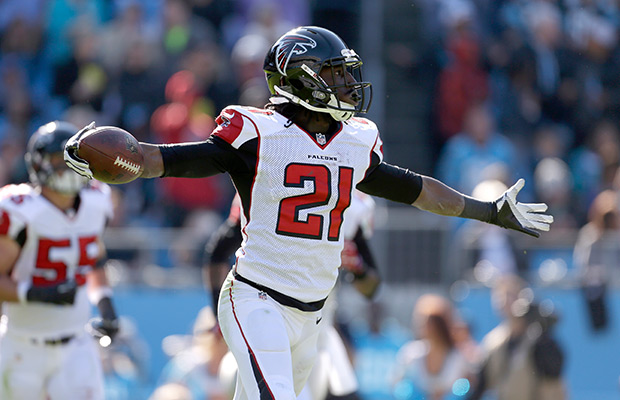 Atlanta Falcons' Desmond Trufant (21) asks why his interception against the Carolina Panthers' won't stand during the first half of an NFL football game in Charlotte, N.C., Sunday, Nov. 3, 2013. The Panthers won 34-10.