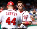 Washington Nationals' Bryce Harper, right,, reacts after grounding out as first base coach Trent Jewett (44) looks in during the eighth inning against the New York Mets at a baseball game at Nationals Park in Washington, on Thursday, June 7, 2012. The Mets won 3-1.