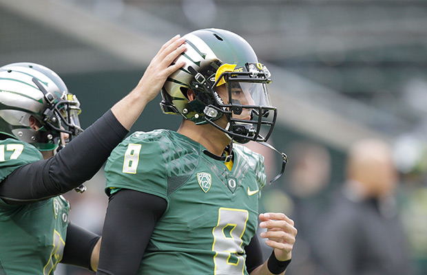 Oregon quarterback Marcus Mariota is shown warming up for an NCAA college football game against UCLA in Eugene, Ore., Saturday, Oct. 26, 2013.