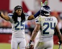 Seattle Seahawks cornerback Richard Sherman (25) greets teammate Marshawn Lynch (24) after Lynch scored a touchdown against the Arizona Cardinals during the second half of an NFL football game, Thursday, Oct. 17, 2013, in Glendale, Ariz.