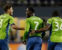 Seattle Sounders' Eddie Johnson (7) celebrates with Brad Evans (3) and Jhon Kennedy Hurtado (34) after they defeated the Colorado Rapids 2-0 on goals from Evans and Johnson in a knockout-round match in the MLS Cup soccer playoffs on Wednesday, Oct. 30, 2013, in Seattle. The Sounders will advance to the Western Conference semifinals Saturday, Nov. 2, 2013, for a first of two aggregate match against the Portland Timbers.