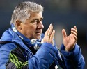 Seattle Sounders head coach Sigi Schmid applauds as he leaves the field after the first game of the Western Conference semifinals in the MLS Cup soccer playoffs against the Portland Timbers, Saturday, Nov. 2, 2013, in Seattle. The Timbers won 2-1 in the first of the two-game aggregate playoff series.