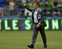 Portland Timbers head coach Caleb Porter gives a thumbs-up to supporters as he walks onto the pitch for the first half of a MLS soccer match against the Seattle Sounders, Sunday, Aug. 25, 2013, in Seattle.