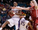 Washington's Jernard Jarreau (33) grabs a rebound from Washington State's Brock Motum as Scott Suggs (15) blocks out in the first half during a Pac-12 tournament NCAA college basketball game, Wednesday, March 13, 2013, in Las Vegas.