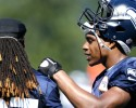 Seattle Seahawks' DeShawn Shead, right, leans against Winston Guy at an NFL football training camp Tuesday, Aug. 6, 2013, in Renton, Wash. (AP Photo/Elaine Thompson)