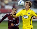 Columbus Crew defenseman Chad Marshall, right, prepares to head the ball as Colorado Rapids forward Herculez Gomez comes in to cover in the first half of an Major League Soccer game in Commerce City, Colo., on Sunday, July 27, 2008.