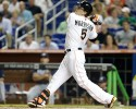 Miami Marlins' Logan Morrison (5) hits a RBI-single to score Christian Yelich in the first inning during a baseball game against the Atlanta Braves, Tuesday, Sept. 10, 2013 in Miami.
