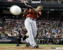 American League's Robinson Cano of the New York Yankees hits during the first round of the MLB Home Run Derby Monday, July 11, 2011, in Phoenix.