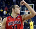 Arizona forward Aaron Gordon (11) walks off the court after defeating Michigan 72-70 in an NCAA college basketball game in Ann Arbor, Mich., Saturday, Dec. 14, 2013.