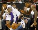 Sacramento Kings guard Ben McLemore, left, and Portland Trail Blazers forward Thomas Robinson chase after the ball during the third quarter of an NBA basketball game in Sacramento, Calif., Saturday, Nov. 9, 2013. The Trail Blazers won 96-85.