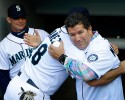 Seattle Mariners former designated hitter Edgar Martinez, right, gets a hug from Mariners' Raul Ibanez before Martinez threw out the ceremonial first pitch of a baseball game against the New York Yankees, Thursday, June 6, 2013, in Seattle.