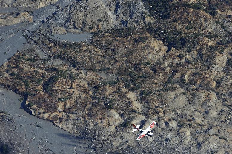 Search crews find more mudslide victims