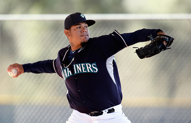 Seattle Mariners' Felix Hernandez throws in a bullpen session during spring training baseball practice, Thursday Feb. 20, 2014, in Peoria, Ariz.