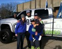 Alex Bannister and family poses with KGMI's Crystal king and Shanna Sheridan at Bellingham's LOB rally.