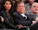 "Los Angeles Clippers owner Donald Sterling, center, and V. Stiviano, left, watch the Clippers play the Los Angeles Lakers during an NBA preseason basketball game in Los Angeles on Monday, Dec. 19, 2011. NBA spokesman Mike Bass said in a statement Saturday, April 26, 2014, that the league is in the process of authenticating the validity of the recording posted on TMZ's website. Bass called the comments ""disturbing and offensive."""