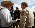 Rancher Cliven Bundy (2nd L) greets Clark County Sheriff Douglas Gillespie in Bunkerville, Nevada, April 12, 2014. Gillespie announced the Bureau of Land Management (BLM) was ceasing its cattle roundup operation.
