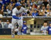 Los Angeles Dodgers' Yasiel Puig batting in the seventh inning of the opening game of Major League baseball in the United States Sunday, March 30, 2014, in San Diego.