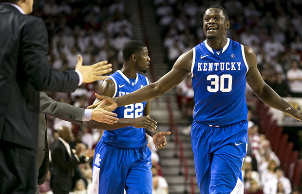 Kentucky guard Julius Randle, 30, runs to his bench to celebrate with his team after a defensive stop during the second half of an NCAA college basketball game against Arkansas, Tuesday, Jan. 14, 2014, in Fayetteville, Ark.