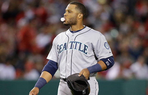 Cano helps M's win in return to Yankee Stadium