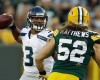 Seattle Seahawks quarterback Russell Wilson tries to avoid the rush of Green Bay Packers outside linebacker Clay Matthews (52) during the first half of an NFL preseason football game Friday, Aug. 23, 2013, in Green Bay, Wis.