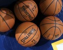 Spalding basketballs sit on floor before the Los Angeles Clippers warm up to face the Denver Nuggets in the first quarter of an NBA basketball game in Denver on Monday, March 17, 2014.