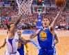 Golden State Warriors guard Klay Thompson, right, puts p a shot as Los Angeles Clippers forward Matt Barnes defends during the first half in Game 1 of an opening-round NBA basketball playoff series, Saturday, April 19, 2014, in Los Angeles.