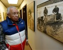 Billy Frank Jr., a Nisqually tribal elder who was arrested dozens of times while trying to assert his native fishing rights during the Fish Wars of the 1960s and '70s, looks at a photo from the late 1960s, Monday, Jan. 13, 2014, that shows him, left, fishing with Don McCloud, right, near Frank's Landing on the Nisqually River in Nisqually, Wash. Several Washington state lawmakers are pushing to give people arrested during the Fish Wars a chance to expunge their convictions from the record.