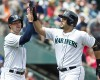 Seattle Mariners' Jesus Montero, right, is congratulated by teammate Cole Gillespie after hitting two-run home run that scored Gillespie during second inning of a baseball game against the San Diego Padres in Seattle, Tuesday, June 17, 2014.