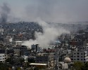 Smoke from an Israeli strike rises over Gaza City, Thursday, July 24, 2014. Israeli tanks and warplanes bombarded the Gaza Strip on Thursday, as Hamas militants stuck to their demand for the lifting of an Israeli and Egyptian blockade in the face of U.S. efforts to reach a cease-fire.
