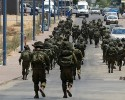 FILE - In this Monday, July 21, 2014 file photo, Israeli soldiers patrol the town of Sderot after a group of Hamas militants was detected infiltrating into Israel. With deadly fighting raging next door in the Gaza Strip, southern Israeli towns along the border have turned into mini army bases as most residents have fled.