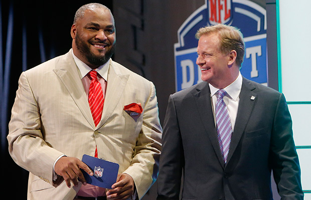 FILE - In this May 9, 2014 file photo, former Seattle Seahawks linebacker Walter Jones, left, walks out on stage with NFL commissioner Roger Goodell to announce the Seahawks pick for the second round of the 2014 NFL Draft in New York. Jones will be inducted into the Pro Football Hall of Fame in Canton, Ohio on Saturday, Aug. 2, 2014.