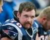 New England Patriots guard Logan Mankins (70) watches from the bench during an NFL football game against the Indianapolis Colts in Foxborough, Mass. Sunday, Dec. 4, 2011.