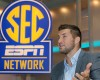 Tim Tebow answers a question during a interview on the set of ESPN's new SEC Network in Charlotte, N.C., Wednesday, Aug. 6, 2014. Tebow has a new job as a commentator for the SEC Network, but is still looking for work in the NFL as a quarterback.