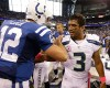 Indianapolis Colts quarterback Andrew Luck, left, meets with Seattle Seahawks quarterback Russell Wilson following an NFL football game in Indianapolis, Sunday, Oct. 6, 2013. The Colts defeated the Seahawks 34-28.
