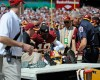 Washington Redskins quarterback Robert Griffin III (10) leaves the game on a cart after injuring his left ankle during the first half of an NFL football game against the Jacksonville Jaguars Sunday, Sept. 14, 2014, in Landover, Md.