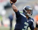 Seattle Seahawks' Russell Wilson throws before a preseason NFL football game against the Chicago Bears, Friday, Aug. 22, 2014, in Seattle.