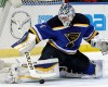 St. Louis Blues goalie Brian Elliott (1) makes a stick-save in the first period of an NHL hockey game against the New York Rangers, Thursday, Oct. 9, 2014, in St. Louis.
